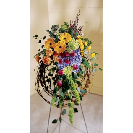 Rural inspired funeral standing spray with gerbera daisies and pink roses