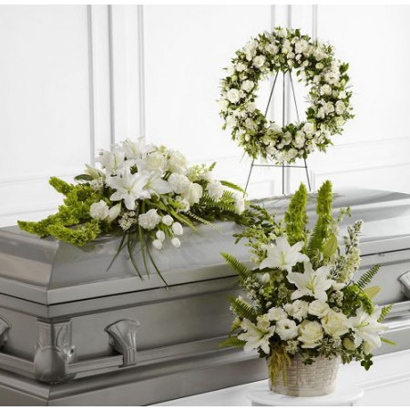 White funeral flowers with casket
