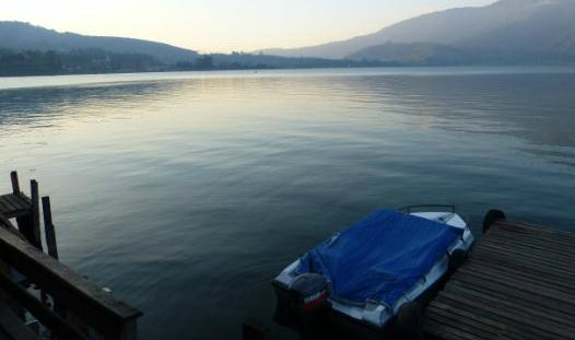 Boat on a cool blue lake expressing loneliness after loss of a wife