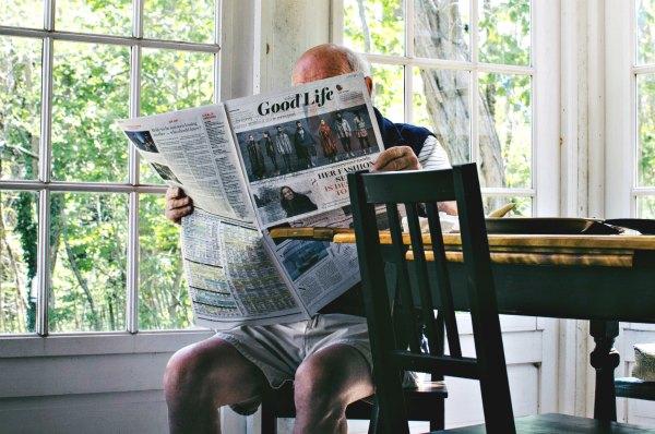 Grandad reading a newspaper entitled Good Life