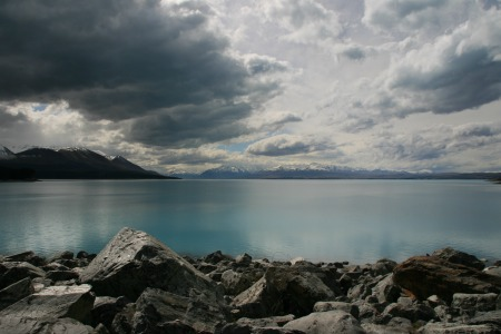Moody Lake in NZ reflecting the turbulence of grief for a father
