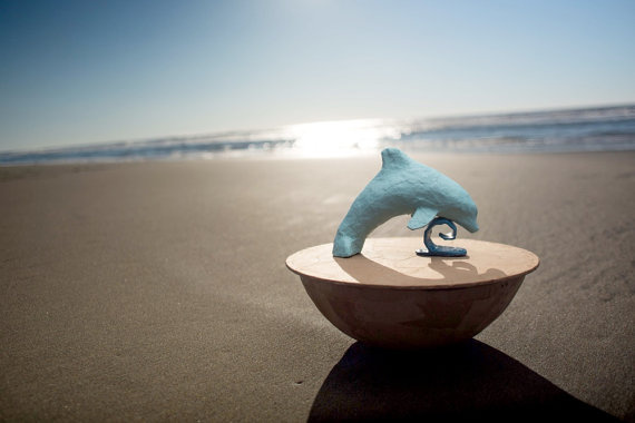 Biodegradable dolphin urn