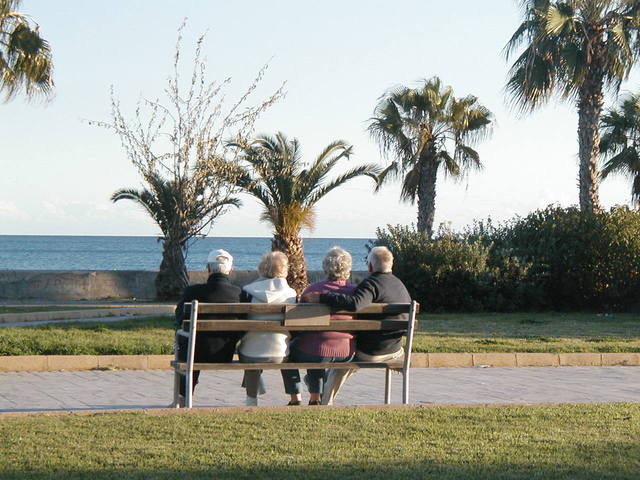 Two couples sitting on a bench to illustrate grief and jealousy of couples