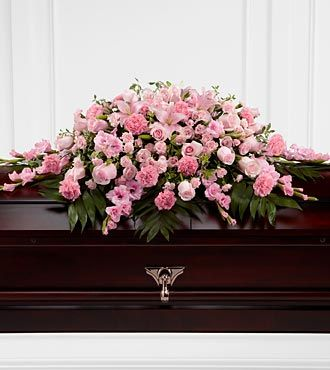 Planning a funeral in 12 easy steps pink funeral flowers for coffin solutioingenieria Images