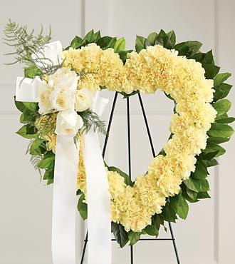 Yellow Heart Shaped Flowers with Carnations and Ivory Roses