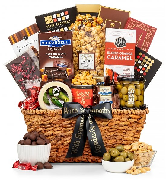 Gourmet Wicker Basket with chocolates, popcorn cheese and olives - In Sympathy