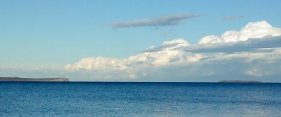 Sea and white clouds, a calming scene for comfort in bereavement