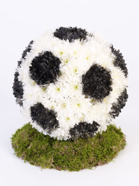 English Football Funeral Flowers in Black and White with Green Moss Grass Base