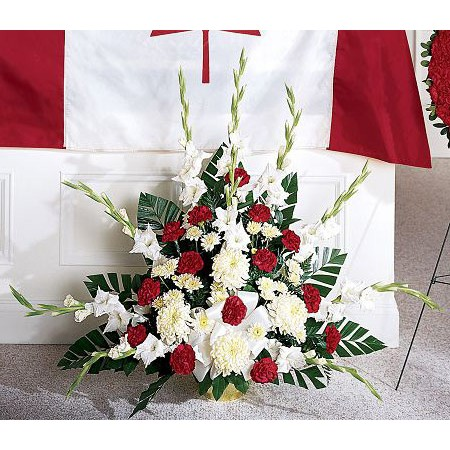 Red white and green military funeral flowers with flag
