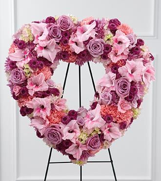 Heart funeral flowers express your love pink and lavender flower wreath with roses mightylinksfo