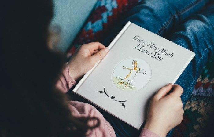 Mom reading a book to a child.  Photo by Annie Spratt on Unsplash