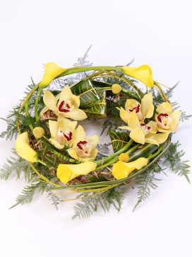 Wreath with Cymbidium orchids and Yellow Calla Lilies on a Willow Frame