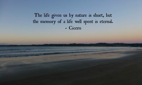 The life given us by nature is short, but the memory of a life well spent is eternal.  Cicero. Meme with seascape background.