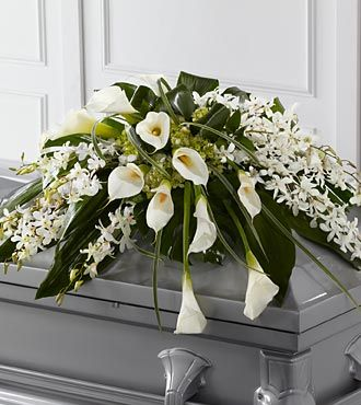 White lilies funeral flower spray