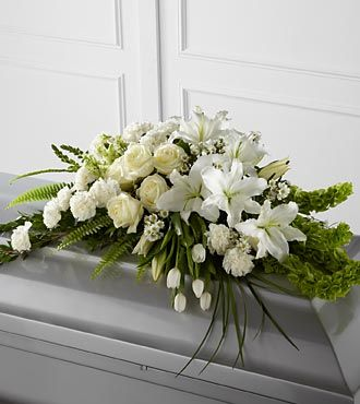 White Funeral Casket Spray with Lilies, Roses, tulips.
