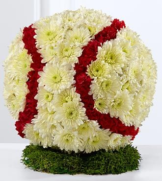 Flowers in the form of a baseball.  Chrysanthemums, yellow and red.