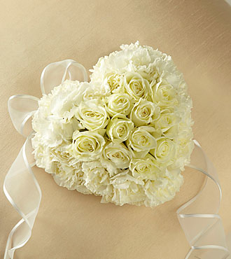 Small heart shaped casket adornment with cream roses