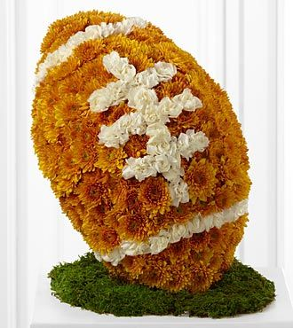 Funeral Flower Tribute in Shape of American football.  Bronze and White.