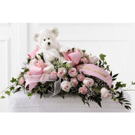 Pink Casket spray with white teddy