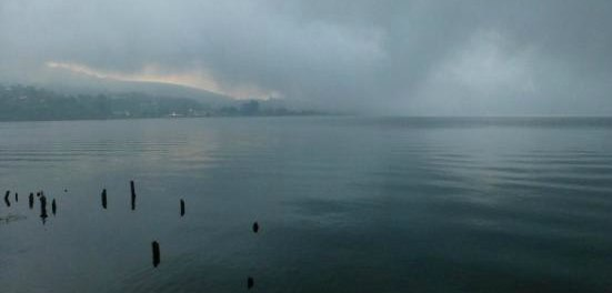Mist over a lake.  Sad and moody expressing grief.