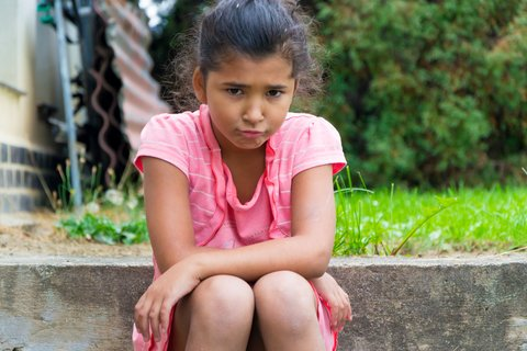 Teenager angry, sad or frustrated because of parents divorce