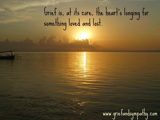 Dark yellow sunrise with quote answering the question What does grief mean?